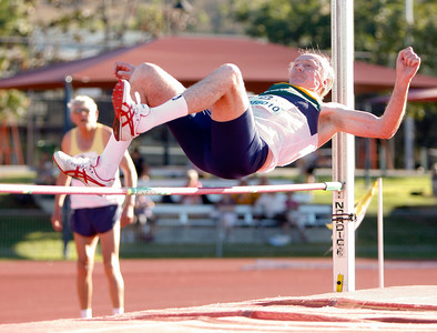 31 July 2008 Townsville, Qld - Competition at the 2008 Oceania Masters athletics meet in Townsville.  Tom Barber clears the bar in the 60-64 age group high jump - Photo: Cameron Laird (Ph: 0418 238811)