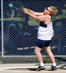 31 July 2008 Townsville, Qld - Competition at the 2008 Oceania Masters athletics meet in Townsville.  Eventual winner Jan Banens competes in the Womens 65-69 age group heavy shot competition - Photo: Cameron Laird (Ph: 0418 238811)