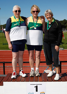 31 July 2008 Townsville, Qld - Competition at the 2008 Oceania Masters athletics meet in Townsville.  Winner of the 65-69 age group heavy shot competition Jan Banens (centre) with 2nd placed Raylea Rudov (left) and Glen Watts (right)  - Photo: Cameron Laird (Ph: 0418 238811)