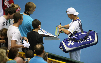 12 April 2008 Townsville, Qld, Australia: Lleyton Hewitt and Paul Hanley sign autographs after their Davis Cup doubles match with Paul Hanley against Thailand's Weerapat Doakmaiklee and Kirati Siributwong.  Australia won in straight sets taking the round - three rubbers to nil - Photo: Cameron Laird (Ph: 0418 238811)