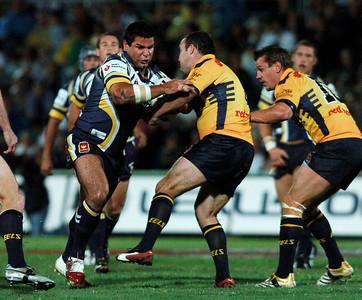 01 SEP 2006 TOWNSVILLE, QLD - Carl Webb runs at Mark Riddell - North Queensland Cowboys v Parramatta Eels (Dairy Farmers Stadium) - PHOTO: CAMERON LAIRD