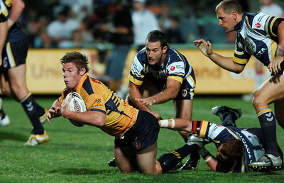 01 SEP 2006 TOWNSVILLE, QLD - Glenn Morrison is dragged down by Steve Southern - North Queensland Cowboys v Parramatta Eels (Dairy Farmers Stadium) - PHOTO: CAMERON LAIRD