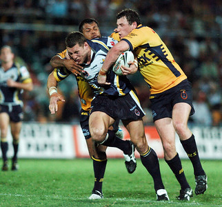 01 SEP 2006 TOWNSVILLE, QLD - Luke O'Donnell tries to break clear of defender Dean Widders and Brett Delaney - North Queensland Cowboys v Parramatta Eels (Dairy Farmers Stadium) - PHOTO: CAMERON LAIRD