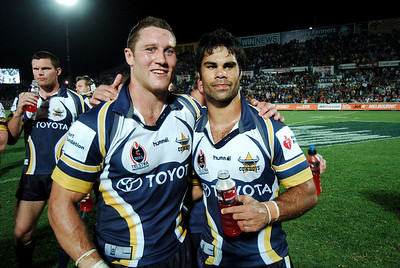 01 SEP 2006 TOWNSVILLE, QLD - Luke O'Donnell and Matt Sing celebrate the Cowboys win - North Queensland Cowboys v Parramatta Eels (Dairy Farmers Stadium) - PHOTO: CAMERON LAIRD
