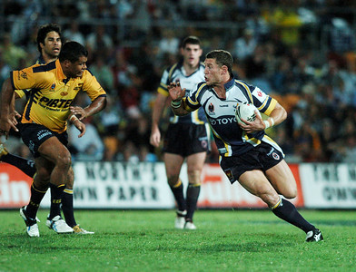 01 SEP 2006 TOWNSVILLE, QLD - Luke O'Donnell tries to break clear of defender Dean Widders - North Queensland Cowboys v Parramatta Eels (Dairy Farmers Stadium) - PHOTO: CAMERON LAIRD