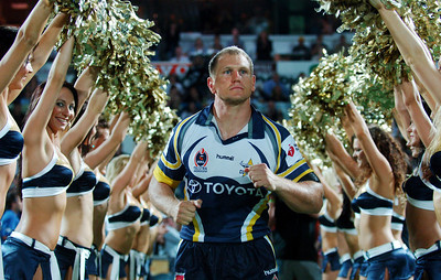 01 SEP 2006 TOWNSVILLE, QLD - Travis Norton leads his team onto the field for the last time - North Queensland Cowboys v Parramatta Eels (Dairy Farmers Stadium) - PHOTO: CAMERON LAIRD