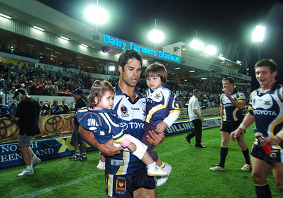 01 SEP 2006 TOWNSVILLE, QLD - Matt Sing takes his children on a lap of honour to celebrate the Cowboys win and Matt's last game in Townsville - North Queensland Cowboys v Parramatta Eels (Dairy Farmers Stadium) - PHOTO: CAMERON LAIRD