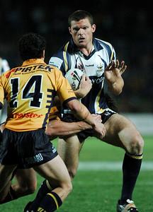 01 SEP 2006 TOWNSVILLE, QLD - Ray Cashmere runs at Parramatta defender PJ Marsh - North Queensland Cowboys v Parramatta Eels (Dairy Farmers Stadium) - PHOTO: CAMERON LAIRD