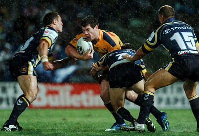 01 SEP 2006 TOWNSVILLE, QLD - Brett Delaney is wrapped up by Aaron Payne -  North Queensland Cowboys v Parramatta Eels (Dairy Farmers Stadium) - PHOTO: CAMERON LAIRD
