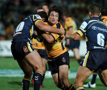 01 SEP 2006 TOWNSVILLE, QLD - Nathan Hindmarsh is wrapped up by Ray Cashmere - North Queensland Cowboys v Parramatta Eels (Dairy Farmers Stadium) - PHOTO: CAMERON LAIRD