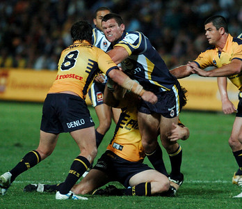 01 SEP 2006 TOWNSVILLE, QLD - Ray Cashmere is caught in a Parramatta tackle - North Queensland Cowboys v Parramatta Eels (Dairy Farmers Stadium) - PHOTO: CAMERON LAIRD