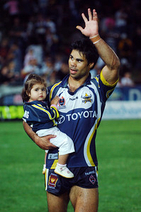 01 SEP 2006 TOWNSVILLE, QLD - Matt Sing takes one of his children on a lap of honour to celebrate the Cowboys win and Matt's last game in Townsville - North Queensland Cowboys v Parramatta Eels (Dairy Farmers Stadium) - PHOTO: CAMERON LAIRD