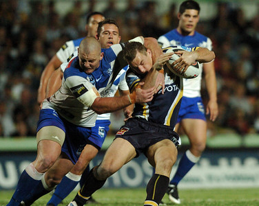 08 Sep 2007 Townsville, Qld, Australia - Ashley Graham is caught high by Mark O'Meley - North Queensland Cowboys v Bulldogs (Dairy Farmers Stadium) - PHOTO: CAMERON LAIRD (Ph: 0418 238811)