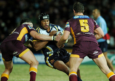 TOWNSVILLE, QLD 13 JUL 2007 - Ty Williams is smashed by Darius Boyd and Craig Frawley - North Queensland Cowboys v Brisbane Broncos (Dairy Farmers Stadium) - PHOTO: CAMERON LAIRD (PH 0418 238811)