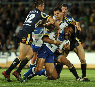 31 Aug 2007 Townsville, Qld, Australia - Daryl Millard is brought down by the Cowboys defence - North Queensland Cowboys v Bulldogs (Dairy Farmers Stadium) - PHOTO: CAMERON LAIRD (Ph: 0418 238811)