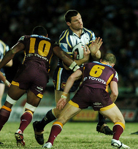 TOWNSVILLE, QLD 13 JUL 2007 - Ray Cashmere is smashed by Petero Civoniceva and Darren Lockyer - North Queensland Cowboys v Brisbane Broncos (Dairy Farmers Stadium) - PHOTO: CAMERON LAIRD (PH 0418 238811)