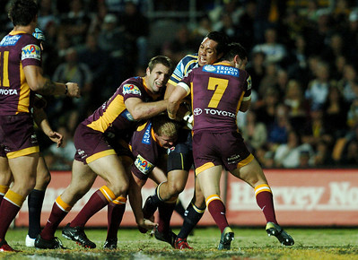 TOWNSVILLE, QLD 13 JUL 2007 - Cowboys Sione Faumuini is smashed by the Broncos defence - North Queensland Cowboys v Brisbane Broncos (Dairy Farmers Stadium) - PHOTO: CAMERON LAIRD (PH 0418 238811)