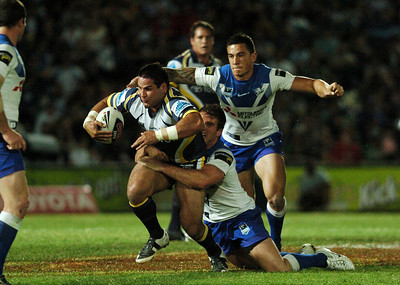 31 Aug 2007 Townsville, Qld, Australia - Carl Webb tries to break clear of a Chris Armit tackle - North Queensland Cowboys v Bulldogs (Dairy Farmers Stadium) - PHOTO: CAMERON LAIRD (Ph: 0418 238811)