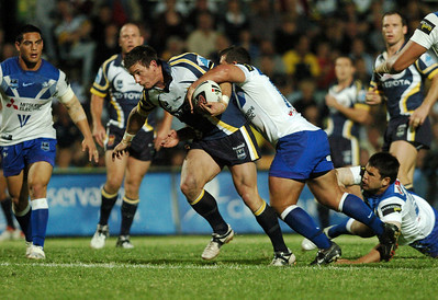 31 Aug 2007 Townsville, Qld, Australia - Jacob Lillyman tries to break clear of a Bulldogs defender - North Queensland Cowboys v Bulldogs (Dairy Farmers Stadium) - PHOTO: CAMERON LAIRD (Ph: 0418 238811)