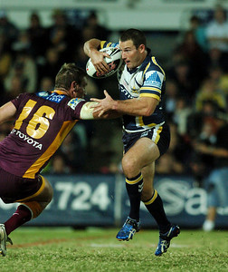 TOWNSVILLE, QLD 13 JUL 2007 - Aaron Payne tries to break clear of Brad Thorn - North Queensland Cowboys v Brisbane Broncos (Dairy Farmers Stadium) - PHOTO: CAMERON LAIRD (PH 0418 238811)