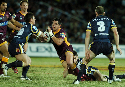 TOWNSVILLE, QLD 13 JUL 2007 - Corey Parker runs at Jacob Lillyman - North Queensland Cowboys v Brisbane Broncos (Dairy Farmers Stadium) - PHOTO: CAMERON LAIRD (PH 0418 238811)