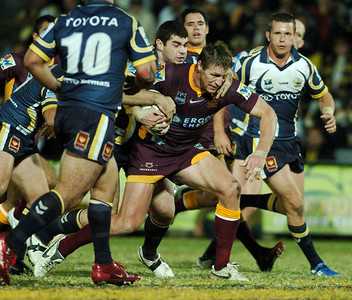 TOWNSVILLE, QLD 13 JUL 2007 - Brad Thorn is brought down by Shane Tronc - North Queensland Cowboys v Brisbane Broncos (Dairy Farmers Stadium) - PHOTO: CAMERON LAIRD (PH 0418 238811)