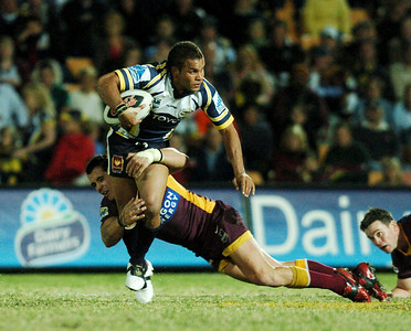 TOWNSVILLE, QLD 13 JUL 2007 - Matt Bowen is wrapped up by a Broncos defender - North Queensland Cowboys v Brisbane Broncos (Dairy Farmers Stadium) - PHOTO: CAMERON LAIRD (PH 0418 238811)