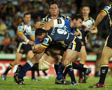 08 Sep 2007 Townsville, Qld, Australia - Jarrad Hickey is caught by Cowboys hooker Aaron Payne - North Queensland Cowboys v Bulldogs (Dairy Farmers Stadium) - PHOTO: CAMERON LAIRD (Ph: 0418 238811)