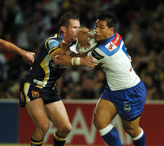 08 Sep 2007 Townsville, Qld, Australia - Matt Utai tries to escape a Justin Smith tackle - North Queensland Cowboys v Bulldogs (Dairy Farmers Stadium) - PHOTO: CAMERON LAIRD (Ph: 0418 238811)