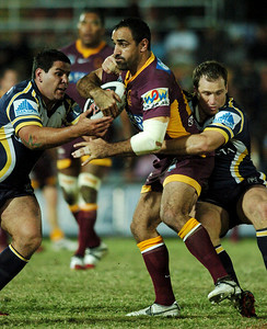 TOWNSVILLE, QLD 13 JUL 2007 - Carl Webb looks to steal the ball from Tonie Carroll - North Queensland Cowboys v Brisbane Broncos (Dairy Farmers Stadium) - PHOTO: CAMERON LAIRD (PH 0418 238811)