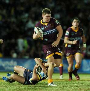 TOWNSVILLE, QLD 13 JUL 2007 - Greg Eastwood escapes an ankle tackle by Aaron Payne - North Queensland Cowboys v Brisbane Broncos (Dairy Farmers Stadium) - PHOTO: CAMERON LAIRD (PH 0418 238811)