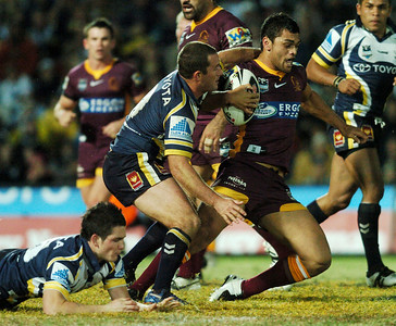 TOWNSVILLE, QLD 13 JUL 2007 - Karmichael Hunt is caught by Aaron Payne - North Queensland Cowboys v Brisbane Broncos (Dairy Farmers Stadium) - PHOTO: CAMERON LAIRD (PH 0418 238811)