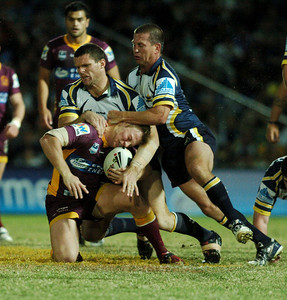 TOWNSVILLE, QLD 13 JUL 2007 - David Stagg is caught by Ray Cashmere and Jason Smith - North Queensland Cowboys v Brisbane Broncos (Dairy Farmers Stadium) - PHOTO: CAMERON LAIRD (PH 0418 238811)