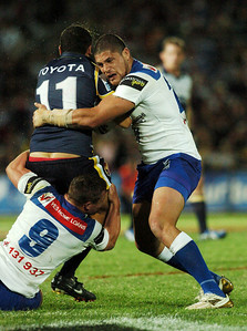 31 Aug 2007 Townsville, Qld, Australia - Willie Mason wraps up Cowboys Sam Faust - North Queensland Cowboys v Bulldogs (Dairy Farmers Stadium) - PHOTO: CAMERON LAIRD (Ph: 0418 238811)