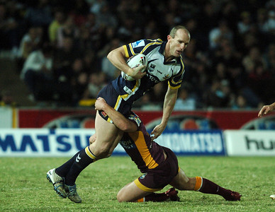 TOWNSVILLE, QLD 13 JUL 2007 - Scott Minto is brought down by a Broncos defender - North Queensland Cowboys v Brisbane Broncos (Dairy Farmers Stadium) - PHOTO: CAMERON LAIRD (PH 0418 238811)
