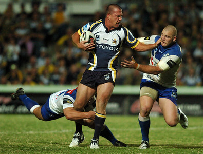 08 Sep 2007 Townsville, Qld, Australia - Jason Smith pushes off Mark O'Meley on the second half of the Cowboys 20-18 win over the Bulldogs - North Queensland Cowboys v Bulldogs (Dairy Farmers Stadium) - PHOTO: CAMERON LAIRD (Ph: 0418 238811)