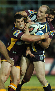 TOWNSVILLE, QLD 13 JUL 2007 - Scott Minto is wrapped up by Michael Ennis and Dane Carlaw - North Queensland Cowboys v Brisbane Broncos (Dairy Farmers Stadium) - PHOTO: CAMERON LAIRD (PH 0418 238811)