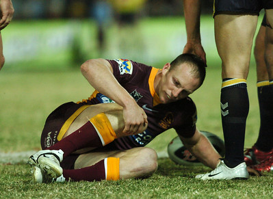 TOWNSVILLE, QLD 13 JUL 2007 - Darren Lockyer in agony after a knee injury sustained in the second half - North Queensland Cowboys v Brisbane Broncos (Dairy Farmers Stadium) - PHOTO: CAMERON LAIRD (PH 0418 238811)