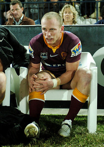 TOWNSVILLE, QLD 13 JUL 2007 - Darren Lockyer in agony on the bench after a knee injury sustained in the second half - North Queensland Cowboys v Brisbane Broncos (Dairy Farmers Stadium) - PHOTO: CAMERON LAIRD (PH 0418 238811)