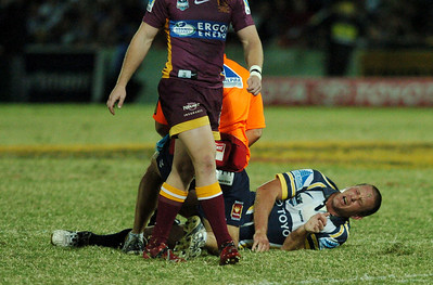 TOWNSVILLE, QLD 13 JUL 2007 - Jason Smith writhes in agony after a first half leg injury - North Queensland Cowboys v Brisbane Broncos (Dairy Farmers Stadium) - PHOTO: CAMERON LAIRD (PH 0418 238811)