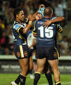 08 Sep 2007 Townsville, Qld, Australia - David Faiumu and Jason Smith congratulate Johnathan Thurston on a try - North Queensland Cowboys v Bulldogs (Dairy Farmers Stadium) - PHOTO: CAMERON LAIRD (Ph: 0418 238811)