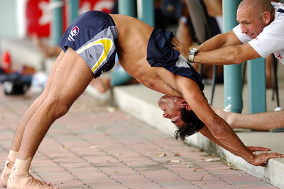 27 SEP 2005 TOWNSVILLE, QLD - Johnathan Thurston stretches with Billy Johnstone after North Queensland Cowboys training - PHOTO: CAMERON LAIRD