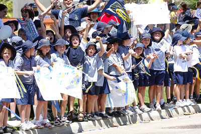 28 SEP 2005 TOWNSVILLE, QLD - Children from Ryan Junior School show their colours during the North Queensland Cowboys bus convoy before the team departed Townsville to take on the Wests Tigers in the NRL grand final - PHOTO: CAMERON LAIRD