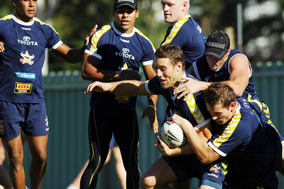 15 AUG 2006 TOWNSVILLE, QLD - Clint Amos and Justin Smith bring down Luke O'Donnell at Cowboys training - PHOTO: CAMERON LAIRD