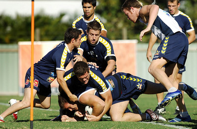 15 AUG 2006 TOWNSVILLE, QLD - Ray Cashmere, Brent McConnell and Josh Hannay bring down Matt Scott at Cowboys training - PHOTO: CAMERON LAIRD