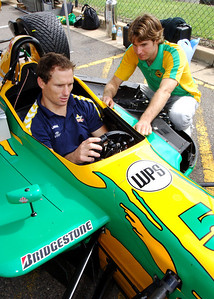 15 JUL 2006 TOWNSVILLE, QLD - Motorsport fans converged on Townsville's Entertainment & Convention Centre for the launch of the Lexmark Indy 300.  Cowboys centre Paul Bowman is given a few tips by Will Power, leading rookie in the Champ car series - PHOTO: CAMERON LAIRD