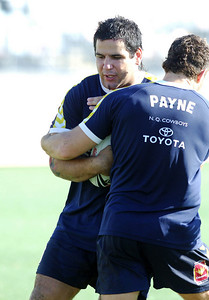 26 AUG 2006 TOWNSVILLE, QLD - Carl Webb is caught by Aaron Payne at Cowboys training before their away match against the Rabbitohs - PHOTO: CAMERON LAIRD