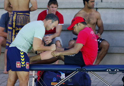 20 AUG 2006 TOWNSVILLE, QLD - Matt Bowen is treated by physio Steve Sartori at Cowboys recovery after their 19-12 loss to the Knights - PHOTO: CAMERON LAIRD