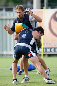 06 January 2009 Townsville, Qld - Dayne Weston tackles Scott Bolton at North Queensland Cowboys training - Photo: Cameron Laird (Ph: 0418 238811)