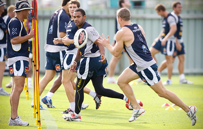 06 January 2009 Townsville, Qld - Watched by Neil Henry Ty Williams passes to Travis Burns at North Queensland Cowboys training - Photo: Cameron Laird (Ph: 0418 238811)